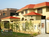 11-exterior-flat-red-clay-roof-tiles-house designs-pictures-gallery